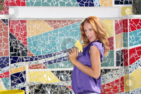 Beautiful Redhead with Mosaic Tiles (4) stock photo, A lovely young redhead stands in front of a mosaic tile waterfall that features a blank white rectangle in the top, which is ideal for displaying text, logos, links, etc. by Carl Stewart
