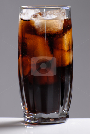 Full Glass of Pop stock photo, A tall glass of pop shot against a grey background by Richard Nelson