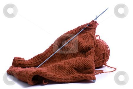 Knitting Supplies stock photo, Red yarn and knitting needles, isolated against a white background by Richard Nelson