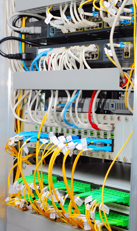 Fiber optic datacenter with media converters and optical cables  stock photo, Fiber optic datacenter with media converters and optical cables by Artush