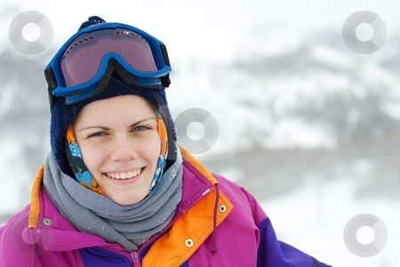 Skier stock photo, Portrait of a young, smiling female skier by P?