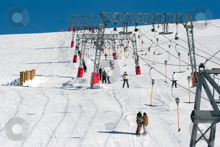 Skiing stock photo, Skiers using a ski lift at a winter resort by P?