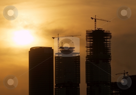Construction stock photo, Construction of skyscrapers in the sunset by P?