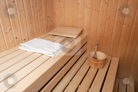 Sauna stock photo, Interior of a finnish sauna with towel and bucket by P?