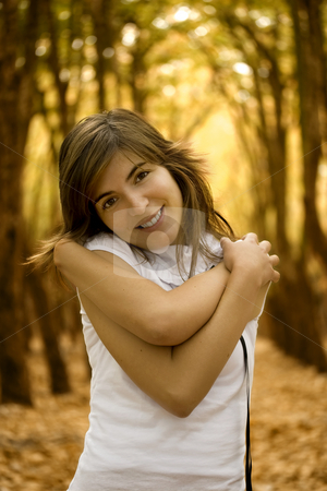 Happy woman stock photo, Beautiful happy woman in the Autumn Park by ikostudio