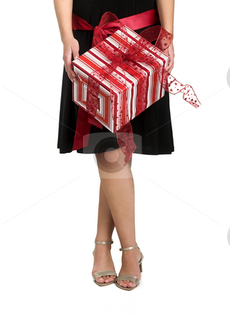 Legs and Gifts stock photo, Studio shot of a women with a gift by ikostudio