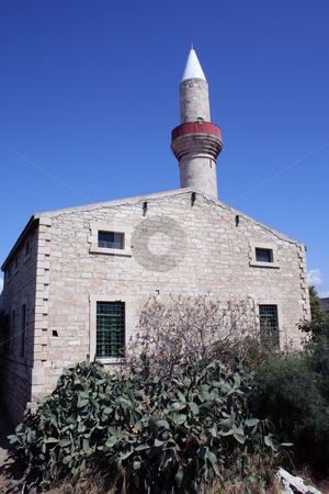 Cyprus house and church stock photo, Rural house with religious minaret tower in background, Cyprus. by Martin Crowdy