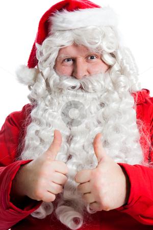 Funny Santa Claus stock photo, Funny Santa Claus holding two thumbs up by Ruta Balciunaite