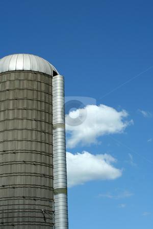 Grain silo stock photo, A grain silo against blue sky by Jim Mills