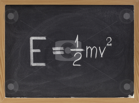 Kinetic energy equation on blackboard stock photo, Kinetic energy equation of classical Newtonian mechanics connecting it to mass and velocity of a point object  - white chalk handwriting on blackboard by Marek Uliasz