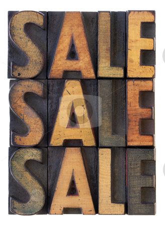 Sale concept - vintage wood types stock photo, The word sale (three versions) in vintage wooden letterpress type, stained by ink, isolated on white by Marek Uliasz
