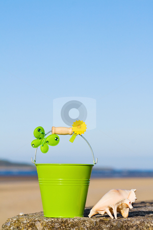 Summer vacations at the beach stock photo, Enjoying the fun of summer holidays at the beach near the ocean. With room for your text. by Andreea Chiper