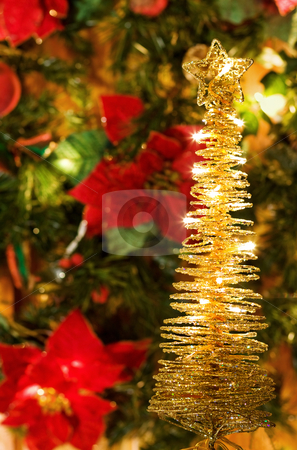 Christmas golden tree stock photo, Celebrating the magic of Christmas with golden lights decorated tree. by Andreea Chiper