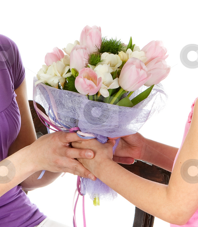 Mother's day flowers stock photo, Hands of a girl giving her mother flowers by Anneke