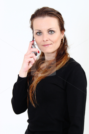The attractive woman talks by a mobile phone on a white background  stock photo, The attractive woman talks by a mobile phone on a white background by Artush