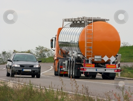 Truck stock photo, Oil transporter truck driving on the road by P?