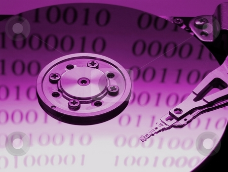 Harddisk stock photo, Internals of a harddisk with binary code reflections by P?