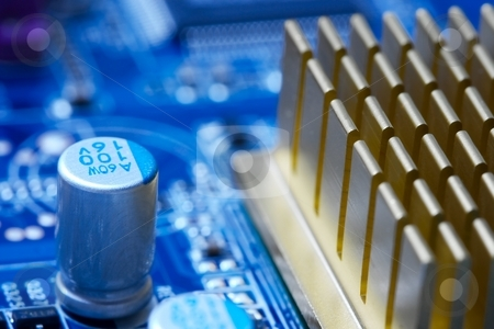 Electronics stock photo, Computer mainboard closeup with electrical components by P?