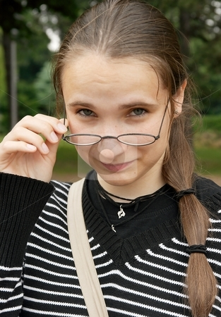 Schoolgirl stock photo, Portrait of a girl wearing glasses by P?