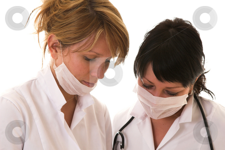 After the operation stock photo, Two nurses checking their work after the operation by Simone Van den Berg