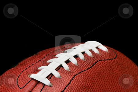 Football Closeup Isolated on Black stock photo, American football closeup isolated on black background. by Danny Hooks