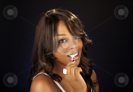 Beautiful BlackWoman, Headshot (10) stock photo, An extraordinarily beautiful young black woman with candy. by Carl Stewart