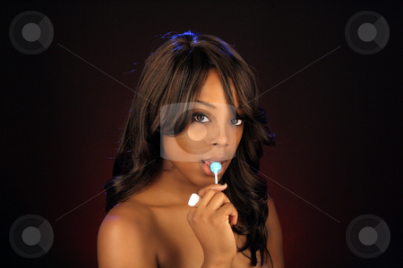 Beautiful BlackWoman, Headshot (18) stock photo, An extraordinarily beautiful young black woman with candy. by Carl Stewart