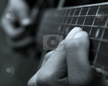 Guitarist stock photo, Closeup of the fingers of a guitar player by P?