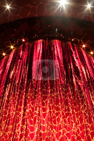 Theater Curtain stock photo, A velvet red theater curtain with traces of gold by Kevin Tietz