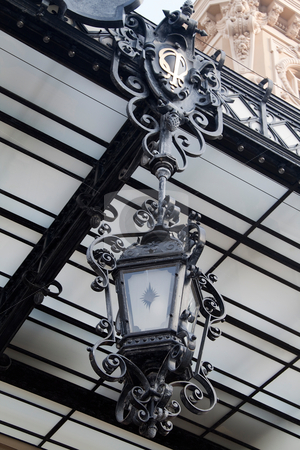 Lantern stock photo, A old looking lantern hanging from a ceiling by Kevin Tietz