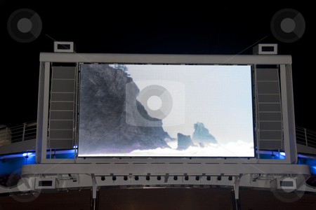 Outdoor Television stock photo, A large LED Television outside on a pool deck by Kevin Tietz