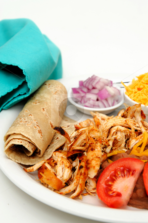 Chicken Tacos stock photo, Shredded grilled spiced chicken on a white plate with fresh tortilla's, refried beans with sides of red onion, cheddar cheese and hot sauce. by Lynn Bendickson