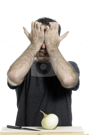 Crying Onion Man stock photo, A young man holding his eyes in pain without even starting to cut the onion, isolated against a white background by Richard Nelson
