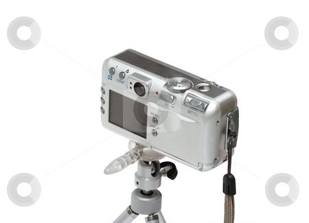 Camera stock photo, Digital camera on a mini tripod by P?