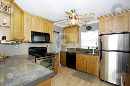 Trendy Modern Kitchen stock photo, Vertial Shot of a Trendy Modern Kitchen by Mehmet Dilsiz