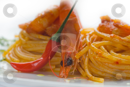 Pasta and spicy shrimps stock photo, Italian spaghetti pasta and fresh spicy shrimps sauce over white by Francesco Perre