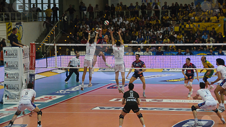 Italian male volley Championship 2009/2010 - ITAS  Diatec Trenti stock photo, Game 1 of Playoff Semifinals between ITAS Diatec Trentino Volley and Lube Banca Marche Macerata. Igor Omrcen hitting the ball against Trento block Photo taken on the 18th of April, 2010. by Alessandro Rizzolli