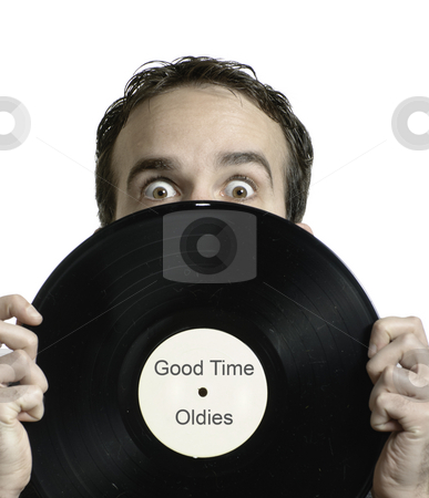 Oldies Music stock photo, Closeup view of a young man holding an old lp record in front of his face, which says Good Time Oldies. *Text in image is done by photographer by Richard Nelson