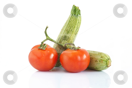 Tomatoes and courgettes stock photo, Two courgettes and two tomatoes isolated on white background by ANTONIO SCARPI