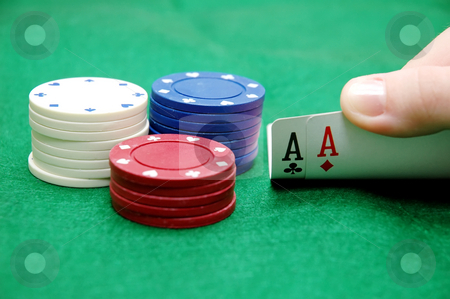 Pocket Aces stock photo, Texas Hold 'em game with a pair of aces and poker chips. by Danny Hooks