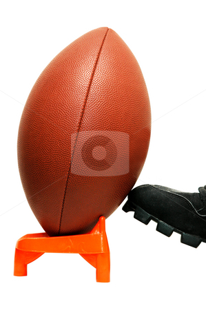 Kickoff stock photo, American football.  Closeup of football being kicked from tee.  Isolated with clipping path. by Danny Hooks