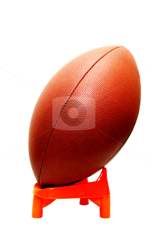 American Football stock photo, American football on kicking tee with clipping path. by Danny Hooks