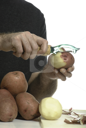 Closeup Peeling Potato stock photo, Closeup view of a person peeling potatoes with a potato peeler, isolated against a white background. by Richard Nelson
