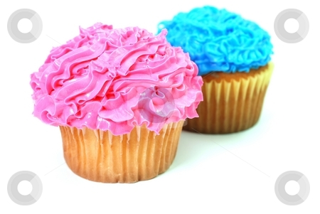 Cupcakes stock photo, Pink and blue cupcakes with decorative frosting.  Isolated on white background. by Danny Hooks