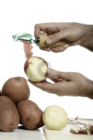 Potato Peeler stock photo, Closeup view of a male hand peeling an organic red potato, isolated against a white background. by Richard Nelson