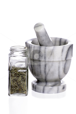 Mortar and Pestle stock photo, A marble mortar and pestle used to grind spices is isolated against a white background. by Richard Nelson
