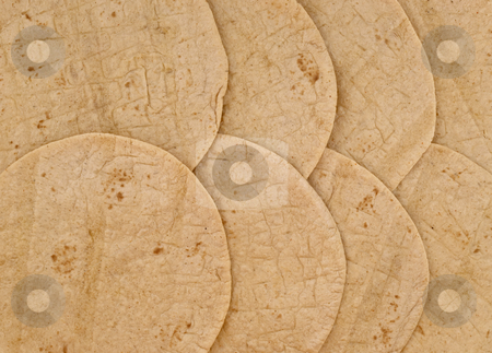 Wheat tortilla background stock photo, Texture and pattern of overlapping wheat flour tortillas by Marek Uliasz