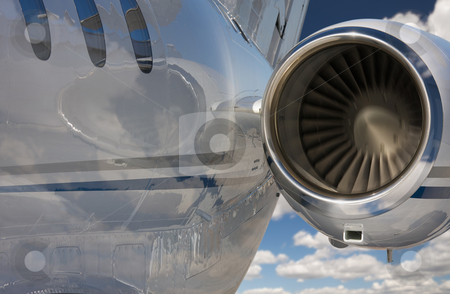 Private Jet Abstract stock photo, Private Jet and Engine Abstract Over Clouds and Sky. by Andy Dean