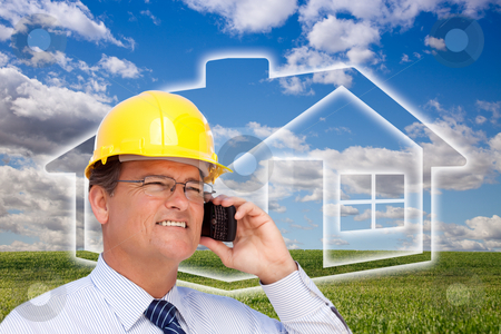 Contractor in Hardhat on Phone Over House, Grass and Clouds stock photo, Contractor in Hardhat on His Cell Phone Over House Icon, Empty Grass Field and Deep Blue Sky with Clouds. by Andy Dean