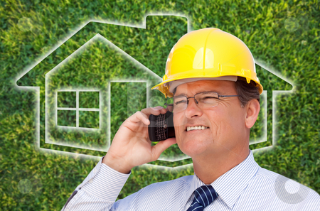 Contractor in Hardhat on Cell Phone Over House Icon and Grass stock photo, Contractor in Hardhat on His Cell Phone Over House Icon and Blurry Grass. by Andy Dean